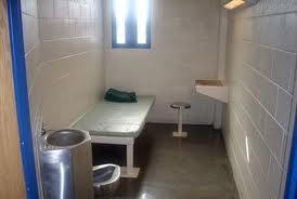 WomenGÇÖs prison solitary confinement cell