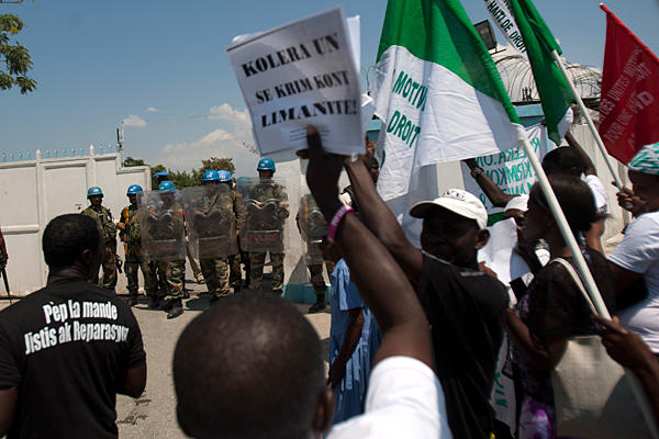 Haitians protest 'Cholera of U.N. is a crime against humanity' Port au Prince 032213 by Dieu Nalio Chery, AP