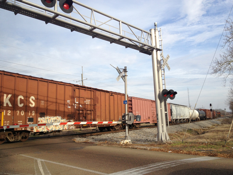 Train-at-railroad-crossing-Jackson-Miss, Jackson Rising: Building the city of the future today, National News & Views