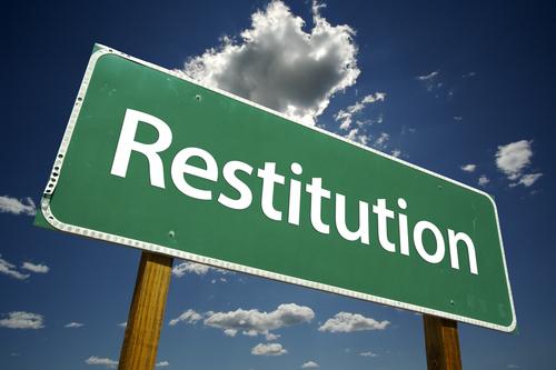 'Restitution' sign
