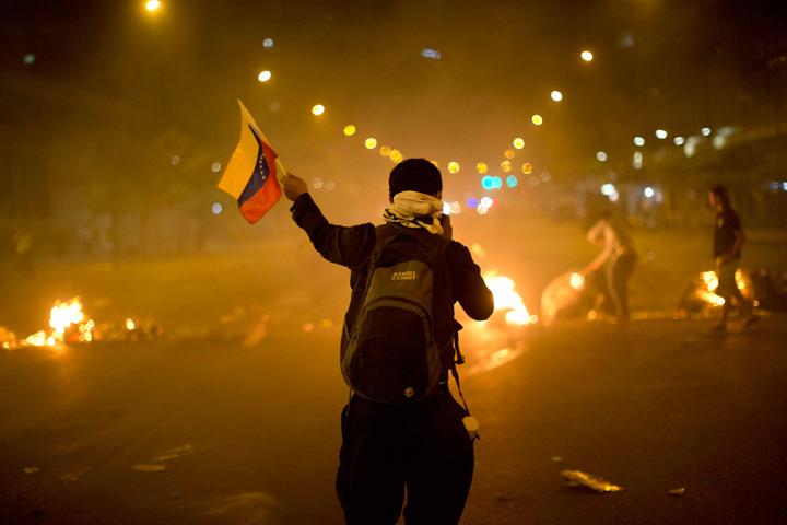 Venezuela anti-government demonstrator CaracasGÇÖ Altamira neighborhood 022114 by Rodrigo Abd, AP