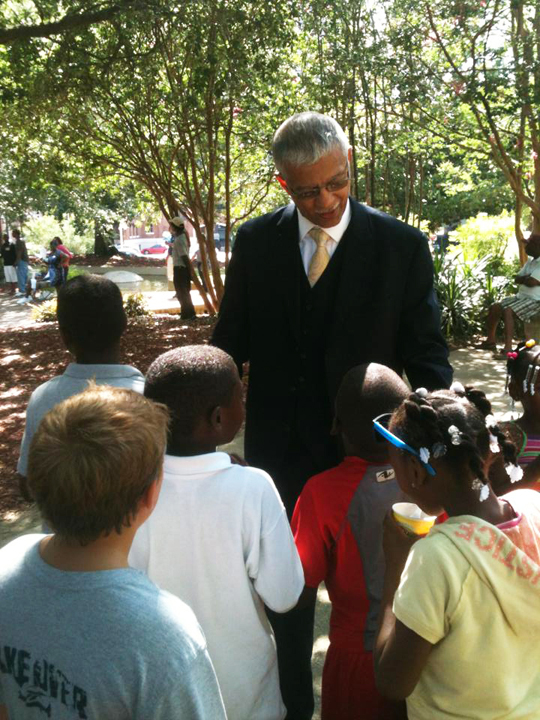 Mayor-elect Chokwe Lumumba with children in park at pre-inaugural block party, web