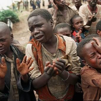Rwandan refugee children plead to cross bridge to Zaire during 1994 genocide by AP
