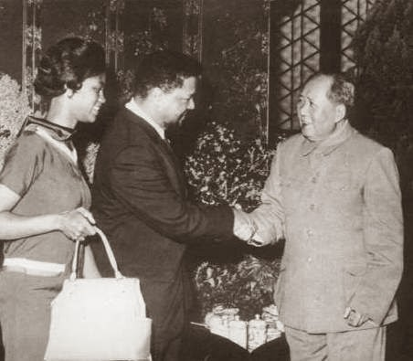 Mabel and Robert F. Williams are greeted by Mao Tse-Tung.