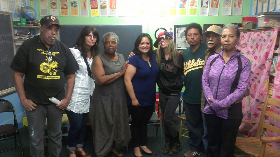 Supporters remain determined to keep Marcus Books alive in San Francisco: From left, an unnamed supporter, Denise Sullivan, Gail Meadows, Grace Martinez, Tiny (Lisa Gray-Garcia), Tony Robles, Greg Johnson and Karen Johnson. – Photo: Poor News Network