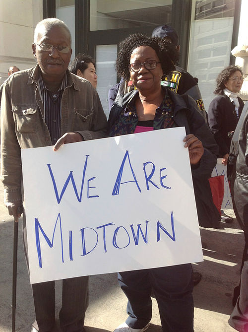 """Since the Christmas Eve calamity, Midtown residents have organized the """"We Are Midtown"""" campaign seeking community support. – Photo: Mike Koozmin, SF Weekly"""