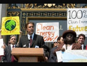 San Francisco Sheriff and former Supervisor Ross Mirkarimi addresses a CleanPowerSF rally outside San Francisco City Hall. Hunters Point activist Espanola Jackson stands beside him.