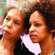 Mother and daughter Karen and Tamiko Johnson listen to speakers at a Save Marcus Books press conference June 10, 2013. Both were raised in the store, which was founded by Raye and Julian Richardson, Karen's parents. – Photo: Malaika Kambon