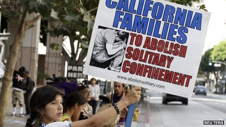 Sidewalk protest 'Cali Families to Abolish Solitary Confinement' by Reuters