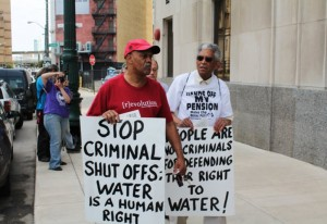 "Every week, as some 3,000 additional families' water is shut off by their ""public"" utility, Detroiters protest on Freedom Friday. – Photo: Ryan Felton"