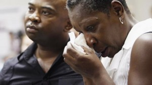 "Elaine Riddick, right, is comforted by her son Tony Riddick during the Justice for Sterilization Victims Foundation task force compensation hearing in Raleigh. Now 57, at 13 she had been raped, and the hospital she was taken to sterilized her without her knowledge or consent. ""I was raped twice,"" she said, ""once by the perpetrator and once by the state of North Carolina."" – Photo: AFP"