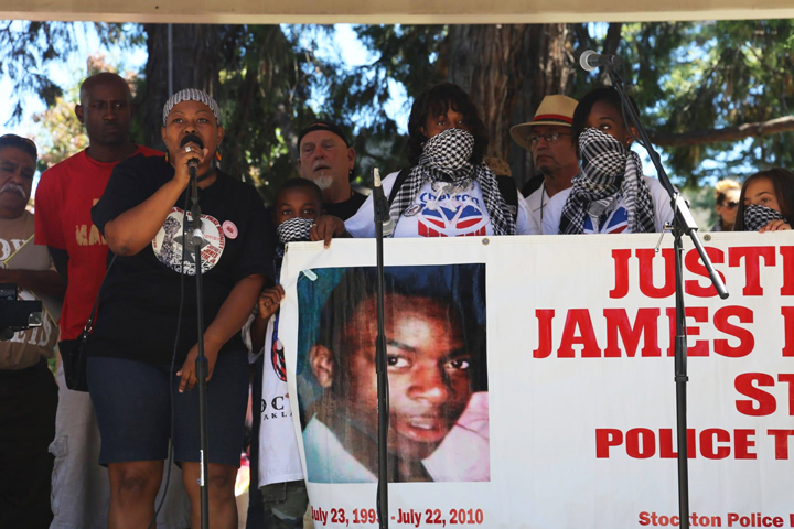 The family of Stockton police murder victim James Rivera, swathed in Palestinian keffiyehs, an international symbol of resistance, came to show their support and spoke passionately at the rally about their four-year quest for justice. – Photo: Daniela Kantorova