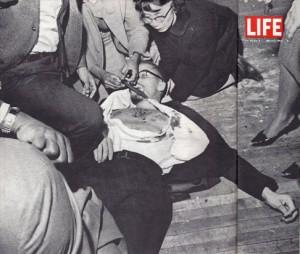 Yuri Kochiyama cradles the head of her assassinated comrade, Malcolm X, in Harlem's Audubon Ballroom on Feb. 21, 1965. – Photo: LIFE Magazine