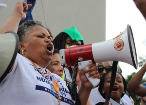 Monica Lewis-Patrick of We the People of Detroit speaks out against cuts to water services for poor residents during July 18 rally and march in downtown Detroit. – Photo: Rasheed Shabazz