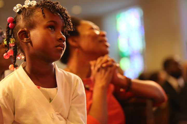 A little girl and her mother remember the world-beloved poet and activist Maya Angelou at the tribute to her at Glide Memorial on June 15. – Photo: TaSin Sabir