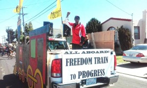 "The Contra Costa Times' Eye on the East Bay's reporting on Richmond's Juneteenth Parade featured Vice Mayor Jovanka Beckles: ""Beckles, who is of African descent and is the first openly gay councilwoman in the city's history, rode in the bed of a pick-up truck decorated with wood panels to look like a locomotive. With the title 'Freedom Train to Progress,' Beckles stood tall and pumped her fist to the incendiary rhythms of Public Enemy's iconic 'Fight the Power,' the theme song of the 1989 Spike Lee film 'Do the Right Thing.' Yellow flags with the words 'freedom' and 'progress' jutted from the faux smokestacks and whipped in the wind. … Powerful song and powerful imagery. Well-played, councilwoman."""