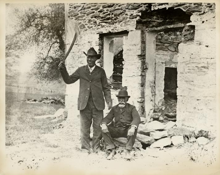 "Samuel Hopkins and Peter Woods, survivors of the Battle of Christiana, the topic of Michael Gene Sullivan's ""fugitive/slave/act,"" returned 45 years later, in 1896, to pose for this photo in front of William Parker's brick house. – Photo courtesy of Moore's Memorial Library, Christiana"