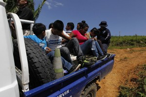 Trying to make their way to the U.S., unaccompanied children and a family are detained in a police truck on the Honduras-Guatamala border. The journey is not an easy one. – Photo: Jorge Cabrera, Reuters