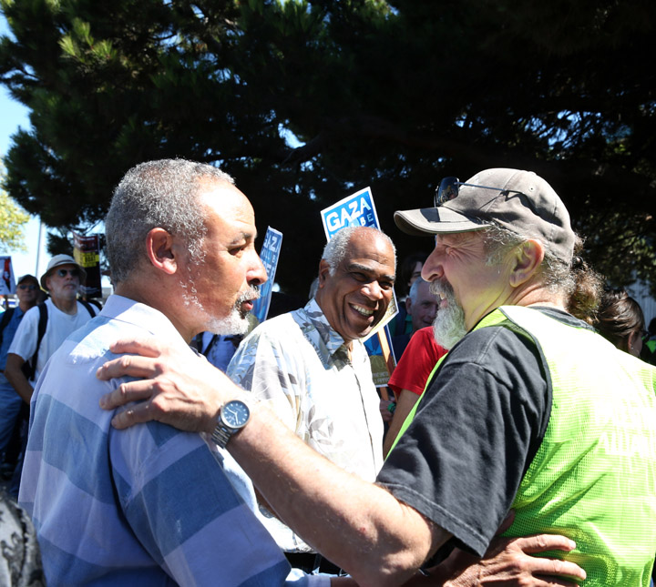 Veteran activists back on the front lines: Phil Hutchings, former leader of SNCC, presently senior organizer for Black Alliance for Just Immigration; Pierre Labossiere, co-founder of the Haiti Action Committee; and Claude Marks, founder of Freedom Archives – Photo: Malaika Kambon