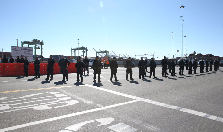 """The thousands who formed a peaceful picket line at the port didn't need a menacing line of cops to """"keep the peace."""" – Photo: Malaika Kambon"""