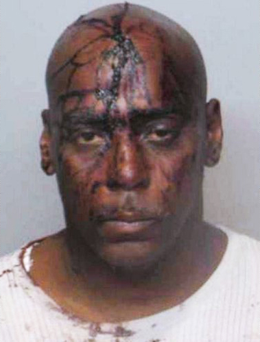 Henry-Davis-52-beaten-by-Ferguson-PD-charged-for-bleeding-on-cops-uniform-092009, Mike Brown appears to have paid for those cigars, National News & Views