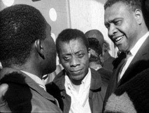 "James Baldwin and Orville Luster speak with youths in ""Take This Hammer"" in 1963. The young people's complaints about San Francisco's progressive veneer covering racism as virulent as in the South are remarkably similar to those voiced by Black youth today. This film is a must-see for the city's entire Black community."