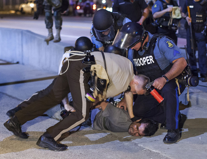 Police are putting their best brutality on display at the nightly protests, and most but not all those attacked are Black. Bilgin Şaşmaz, a photojournalist for Turkey's state run Anadolu Agency, was brutally beaten and arrested by police in Ferguson as he photographed the protests. Similar brutality is regularly used by guards on prisoners.
