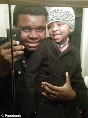 Michael-Brown-young-relative-taking-selfie, Mike Brown appears to have paid for those cigars, National News & Views