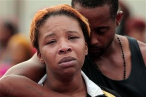 Lesley McSpadden is comforted by her husband, Louis Head, after her 18-year-old son, Michael Brown, was shot and killed by police in the middle of the street in Ferguson, Mo., near St. Louis on Saturday, Aug. 9, 2014. – Photo: Huy Mach, St. Louis Post-Dispatch, AP