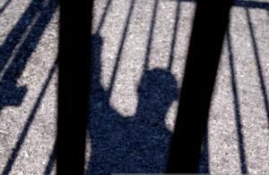 Prisoner's shadow behind bars