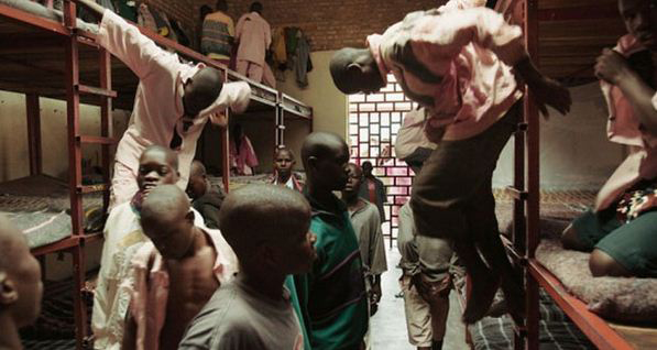 """Life prisoners – all Hutu – in Muhanga (formerly Gitarama) Prison are, according to the Global Research caption, regularly """"hung, cuffed and crucified."""" Some appear very young. Eighty percent of those who are released reportedly live no longer than another year or two. In 1995, the British Independent newspaper described this as the """"worst prison in the world."""" Much of it was destroyed by fire June 5. Were the prisoners inside? Are their bodies in Lake Rweru?"""