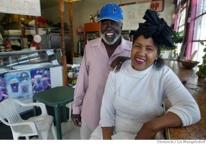 Willie and Ernestine Howard, always kind and generous to everyone, smile for the Chronicle photographer inside their beautiful bakery. Painted pink and white on the outside – looking good enough to eat – Wendy's Cheesecake was a landmark on the corner of Third and Quesada. – Photo: Liz Mangelsdorf, SF Chronicle