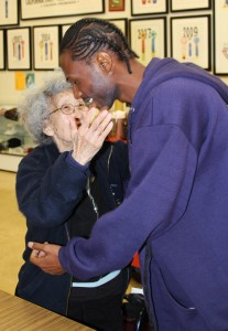 Yuri reaches out to greet Malcolm Shabazz with a big hug. – Photo: Block Report