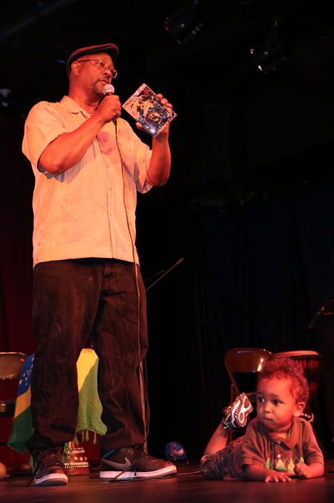 Hard Knock Radio host and BMAN '12 award winner Davey D and his little son mesmerized the audience as Davey explained the urgency of protecting net neutrality to keep the internet fully open and accessible to the people, the latest conflict in a long history of fighting the suppression of Black communication in the U.S. that began with the criminalization of reading, writing and drumming. – Photo: Malaika Kambon