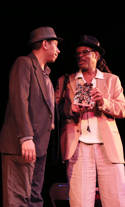The people's engineer, Dev Ross, accepts his award as Champion of Technical Support from KCSM jazz host Greg Bridges, an award winner at BMAN '12. This year's awards were created by renowned artist Eesuu Orundide. – Photo: Malaika Kambon