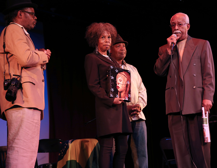 A sense of determination to prevail despite tragic loss permeated the audience in the renowned Buriel Clay Theater as Karen and Gregory Johnson, second generation proprietors of Marcus Books, the oldest Black book store in the country, accepted their lifetime achievement award from Greg Bridges and Emory Douglas. Marcus Books is temporarily closed after a hostile takeover. City Hall's indifference proves San Francisco's contempt for the best in Black culture. – Photo: Malaika Kambon