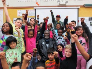 "Elbert ""Big Man"" Howard, founding member of Black Panther Party, speaks to granddaughter Ya'hiness' fifth grade class. – Photo: Carole Hyams Howard"