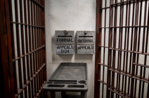 Deposit boxes hang on the wall for prisoner appeals outside the main holding area in Corcoran State Prison's 4B SHU. – Photo: Grant Slater, KPCC