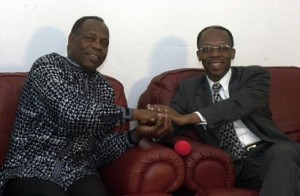 Danny Glover clasps hands with President Aristide in the National Palace on April 9, 2003, about 10 months before the coup, on Feb. 29, 2004. – Photo: Daniel Morel
