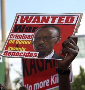 Sign held aloft outside Rwanda Day in London, 2012
