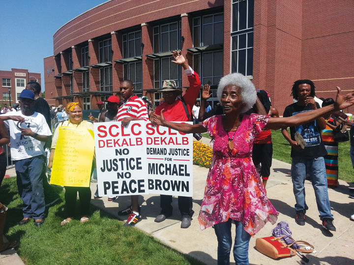 Michael Brown funeral old woman hands up leads protest chants supporting youth 082514 by JR BR, web