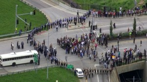 Protesters demanding Gov. Nixon appoint a special prosecutor are surrounded by multiple law enforcement agencies as they try to shut down I-70 on Sept. 10. – Photo: KMOV