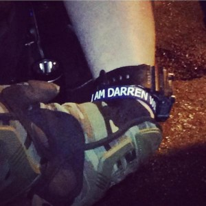 "The New York Times reports: ""The Justice Department on Friday pressured the Ferguson Police Department to stop its officers from wearing bracelets stamped with the message 'I am Darren Wilson,' in solidarity with the police officer who is being investigated for shooting an unarmed Black 18-year-old, and from covering up their name plates with tape."" This photo has been tweeted around the world."