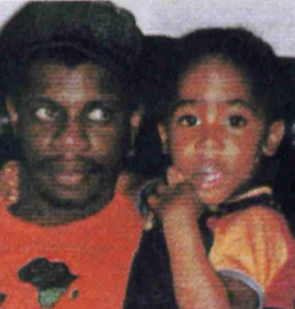 Dr. Mutulu Shakur holds his stepson, Tupac Shakur.