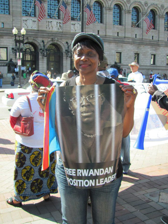 A protester at Rwanda Day in Boston in 2012 held up a poster calling for the freedom of Rwandan political prisoner and opposition leader Victoire Ingabire Umuhoza.