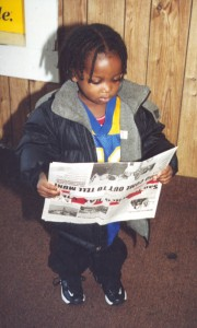 """Even very small children used to tag along with their older siblings to deliver the Bay View door to door in Bayview Hunters Point. Young adults often stop us to ask, """"Do you remember me? I used to carry the paper – and I've read it all my life."""" Poet Curtis Johnson Jr. is one of those wonderful children. The paper in this photo has our pre-2003 masthead."""