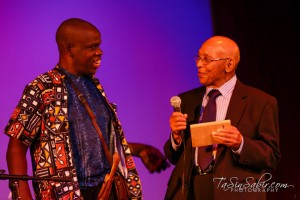Leroy Moore, Champion of Disabled People in Media, accepts his award from Dr. Ratcliff. Leroy has been telling the stories that bring brilliant, talented, beautiful Black disabled people from around the world out of the shadows and into the light of media though the Bay View and Poor Magazine for over 20 years. – Photo: TaSin Sabir