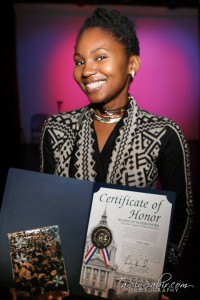 TaSin Sabir displays her BMAN '14 Champion of Photography award and her certificate from San Francisco Supervisors London Breed and Malia Cohen, representing the city's two largest historic Black districts, the Fillmore and Bayview Hunters Point. – Photo: TaSin Sabir