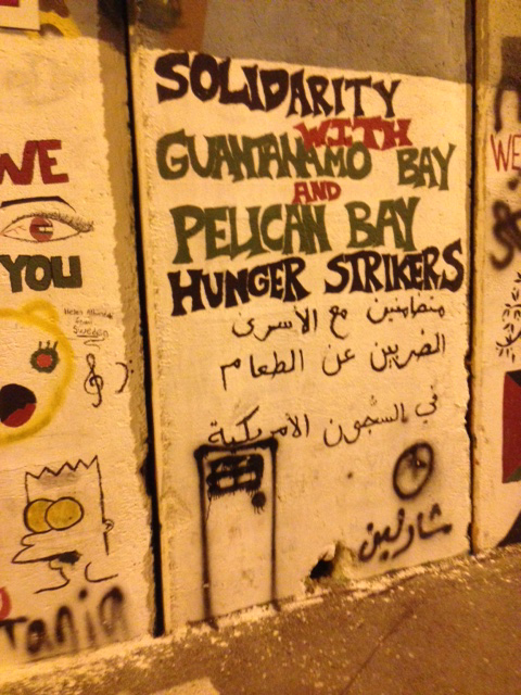 Bethlehem-graffiti-on-Apartheid-wall-Solidarity-with-Guantanamo-Bay-Pelican-Bay-Hunger-Strikers-from-Palestinian-HS-0614-by-Midnight-Jones1, Abu Jihad: A living, fighting museum for prisoner movement affairs, World News & Views