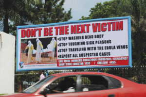 A public health billboard in Monrovia, Liberia, warns and instructs the people. Despite the staggering challenges, Liberia and also Nigeria and Senegal are managing to contain the pandemic.